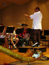 Steve Burian directing with Alp horn and French horn in foreground
