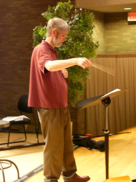 Steve Mumford, directing MMHC choir at Mott College in Flint, MI